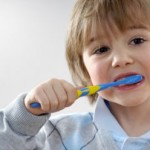image of child brushing to prevent tooth decay